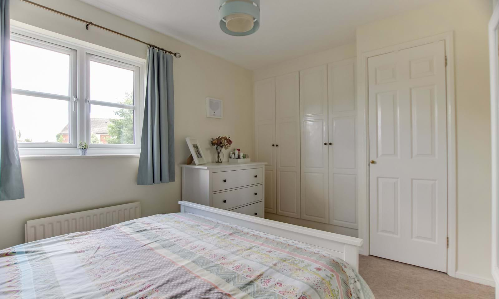man bedroom with built in wardrobes